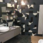 Bathroom, Wooden Floor, Black Hexagonal Floor Tiles, Grey Floating Vanity, White Sink, Blue Abstract Pattern Wall Tiles, Floating Bxes, Mirror, Pendant