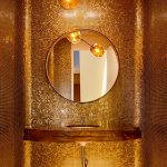 Bathroom, Wooden Floor, Golden Mosaic On The Entire Walls, Molten Gold Pendant, Round Mirror, Wooden Floating Sink