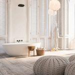Bathroom, Wooden Floor, Rattan Ottoman, White Tub, White Wall, High Arch Window, White Lantern, Wooden Stool And Basket