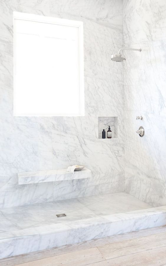 bathroom, wooden floor, white marble on the floor and wall, floating marble shelves, window