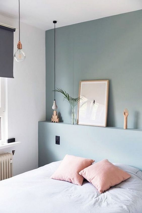 bedroom, green wall, white wall, white bedding, built in indented wall for shelves