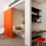 Bedroom, Grey Wall, White Wall, Black Floating Study Table, Red Stool, Orange Door, White Chair