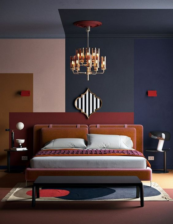 bedroom, pink white floor iwht patterned rug, purple, grey, pink, mustard terracotta on the wall and ceiling, chandelier, pink bed platform, black bench, black side table