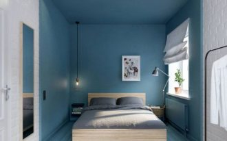 bedroom, plank floor in white and blue, blue bed area wall, wooden bed platform, floating side shelves, floor lamp, long pendant, white open brick wall