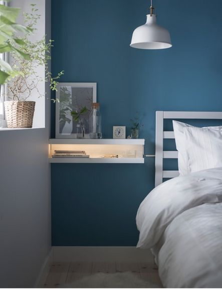 bedroom, wooden floor, grey wall, blue wall, white pendant, white bed platform, white wooden floating side table shelves