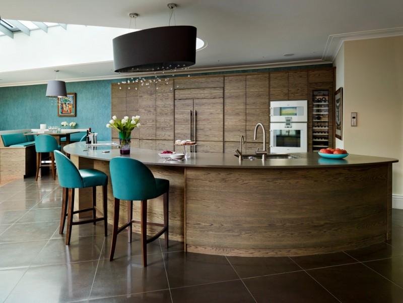 big kitchen islands chandelier with dark shade dark floor tile teal wall teal basrstools countertop flat panel wooden cabinet wine cellar sink stovetop