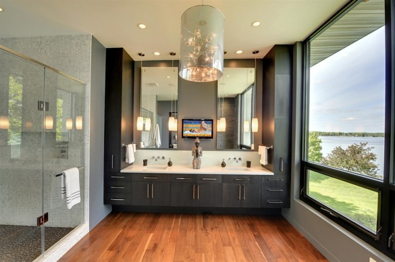 black bathroom cabinets chandelier wall mirrors glass pendant lamps wooden floor white top sinks windows glass shower doors