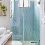 Blue Wall Tile Hexagonal Tile Built In Shelves Window Glass Shower Door Vanity White Sink Bowl Wall Mounted Shelf Toilet White Rainfall Shower Head Towel Holder