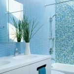 Blue Wall Tile Skylight Mirrored Wall Cabinet White Vanity White Double Sink Faucet Toilet Built In Tub Shower Fixture Blue Towels