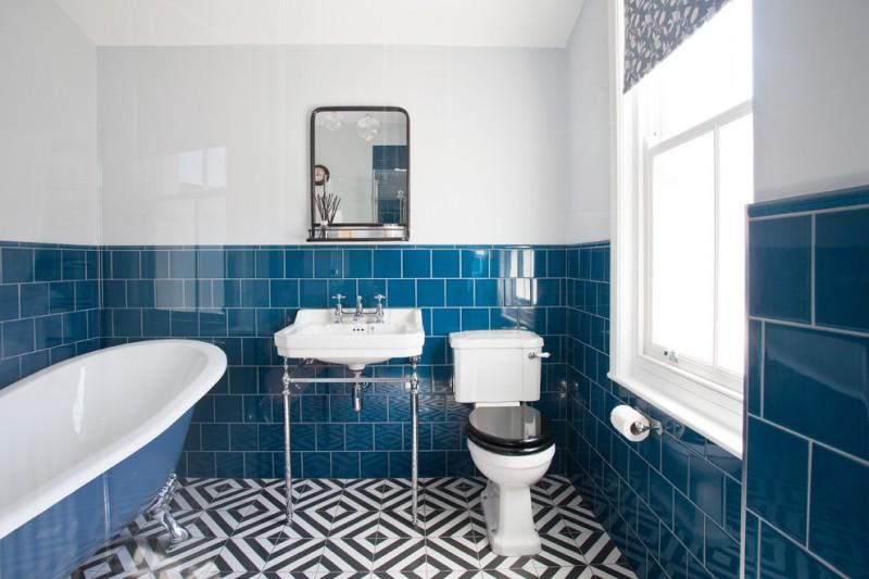 blue wall tile wall tile freestanding sink toilet blue acrylic bathtub black and white geometric floor tale windows window shade shelf