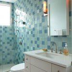 Blue Wall Tile Window Glass Shower Door Toilet Wall Sconce Wall Mirror White Vanity Undermount Sink Shower Fixtures Faucet White Floor Tile
