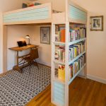 Custom Kids Bed Built In Shelves Built In Ladder Wooden Desk Chair Table Lamp Patterned Rug Wooden Floor Pink Bed Colorful Pillows