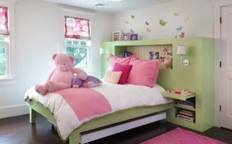 custom kids bed pendant lamp green bed green headboard green built in shelves white wall sconces pink pillows mounted bedside table window shade