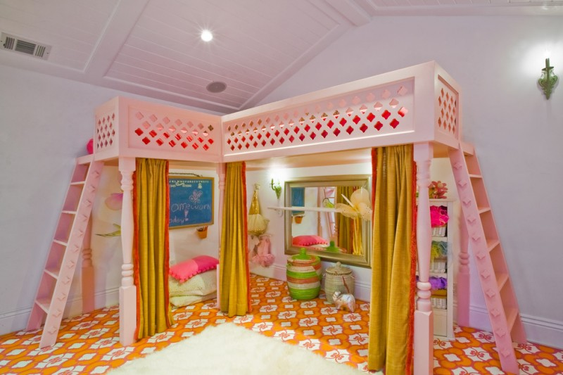 custom kids bed vaulted ceiling wall sconces green drapes colorful flooring pink loft bed large wall mirror pillows bedding shelves
