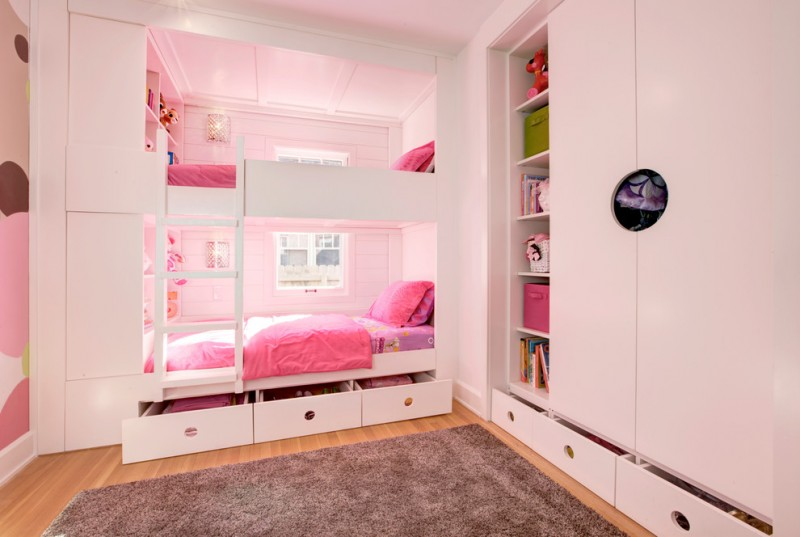 custom kids bed white bed white drawers gray shag rug white shelves white cupboard white ladder windows wall sconces pink bedding pink pillows