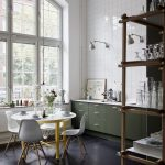 Dining Room, Dark Wooden Floor, White Round Table, White Modern Chairs, White Square Wall Tiles, Tall Glass Window, Shelves, Green Bottom Cabinet