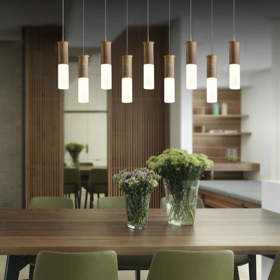 dining room, green chairs, wooden tale, pendant light with thin support