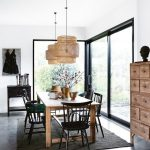 Dining Room, Grey Floor, Black Rug, Wooden Table, Black Woden Chairs, White Wall, White Ceiling, Rattan Pendant, Wooden Cabinet, Black Cabinet