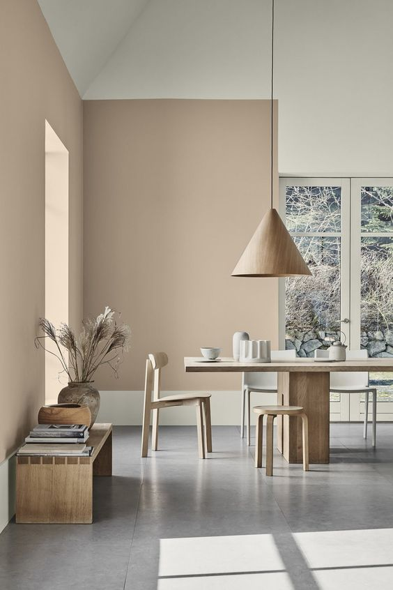 dining room, grey floor tiles, beige wall, wooden table and chairs, wooden stool, wooden pendant