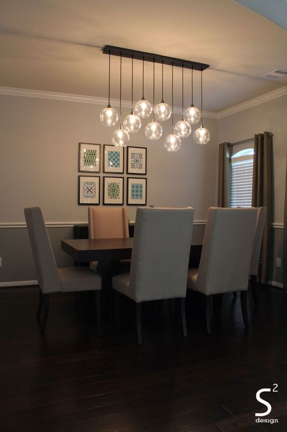 dining room, wooden floor, white chair, wooden table, white wall, wainscoting, straight line fixture with bulbs