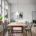Dining Room, Wooden Floor, White Wall, White Ceiling, White Bulb Pendant, Wooden Table, Black Stainless Steel Chairs, Glass Window