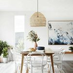Dining Room, Wooden Floor, White Wooden Chairs, Light Wooden Table, Rattan Pendant, White Wall, Floating Shelves