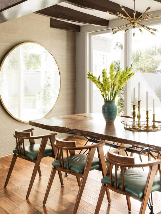 dining set with wooden table, wooden chairs with green cushion, round mirror, modern rigid chandelier