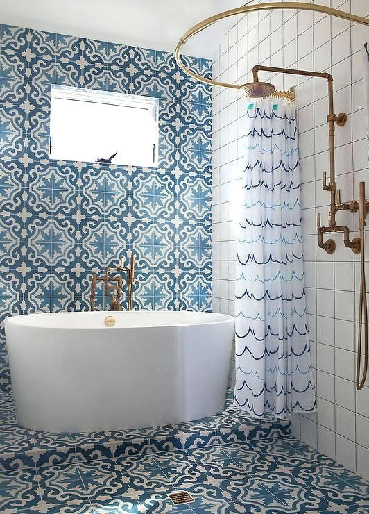 exotic blue tiles on the floor and wall, white square tiles, white curtain, golden ring, golden shower faucet, white tub
