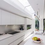 Galley Kitchen, White Floor Tiles, White Cabinet, White Kitchen Top, Long Clear Glass Ceiling, Pendant