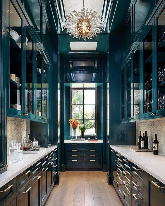 galley kitchen, wooden floor, dark green cabinet wall ceiling, marble backsplash, pendant, window