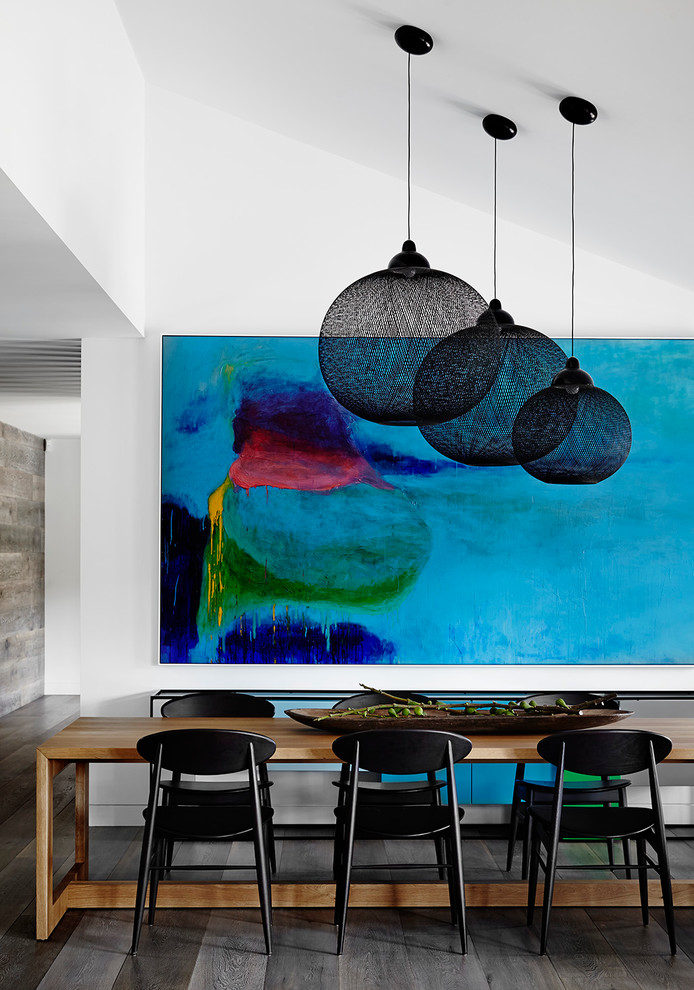giant wall art black pendant lamps colorful artwork white wall wooden dining table modern black dining chairs wooden floor