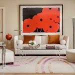 Giant Wall Art Floor Lamp White Sofa White Chars Mirrored Side Table Glass Coffee Table Beige Ottoman Colorful Area Rug Beige Wall