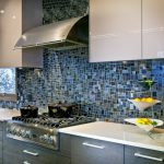 Glass Mosaic Backsplash Black And Blue Mosaic Tile White Countertop Glossy Cabinet Window Sink Faucet Stovetop Range Hood