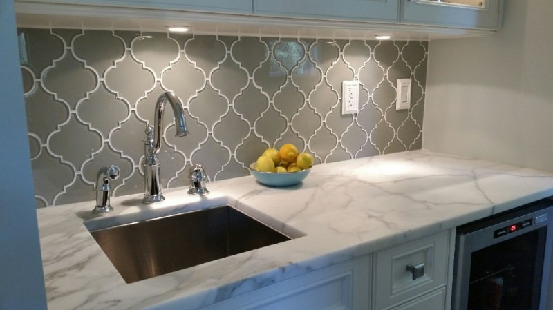 glass mosaic backsplash white marble countertop undermount sink white cabinet drawer chrome faucet wine cellar recessed lighting