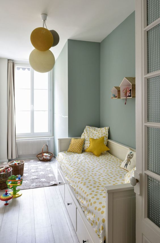 kids bedroom, light wooden floor, grey rug, white wooden sofa bed, green wall, balloon pendant, curtain, floating wall decoration