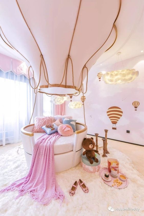 kids bedroom, white floor, pink wall with white cloud, white round bed with air balloon