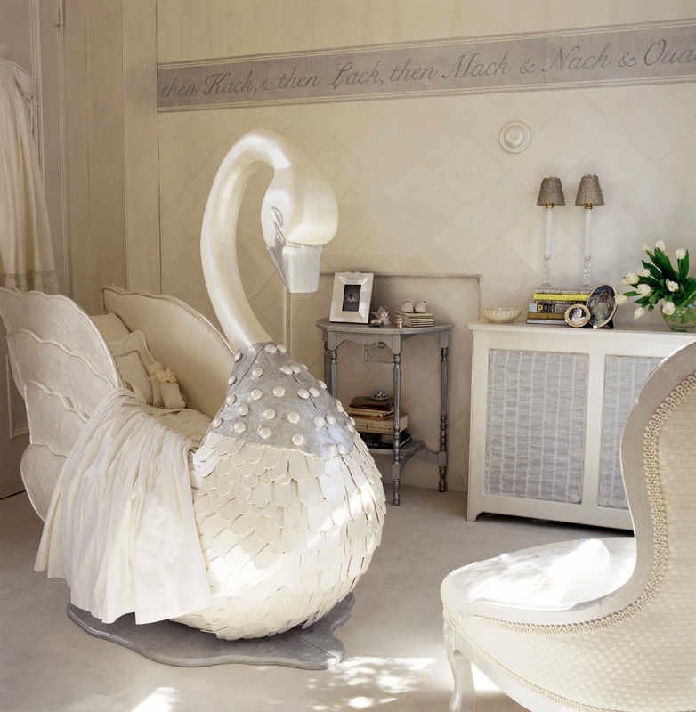kids bedroom, white floor, white chairs, white wall, white cabinet, grey round table, sconces, white duck crib