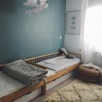 Kids Bedroom, White Wall, Green Wall, Wooden Floor, Rug, Wooden Bed Platform, White Drawer Under, Rattan Ottoman