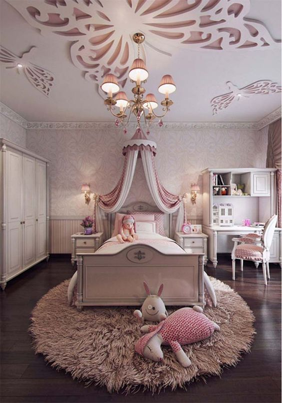 kids bedroom, wooden floor, white wall, buterfly accented ceiling, white bed platform, pink white canopy, white study table and chair