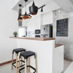 Kitchen Bar With White Floor, White Kitchen, White Bar With Wooden Top, Black Different Pendants, Black Stools