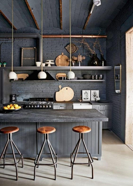 kitchen, beige floor, dark grey open brick wall, dark grey cabinet openshelves island, wooden stool, white pendants