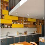 Kitchen, Black Floor Tiles, Grey Bottom Cabinet With White Top, White Backsplash, Yellow Shelves