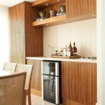Kitchen, Brown Floor Tiles, Wooden Slats On The Bottom Cabinet, Upper Cabinet, And Pantry, Wooden Shelves, Wooden Dining Set