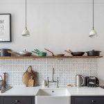 Kitchen, Dark Grey Bottom Cabinet, White Wall, White Pegboard Backsplash, White Kitchen Top, White Apron Sink, Floating Shelves, White Pendants