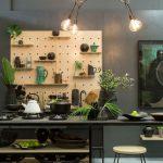 Kitchen, Off White Floor, Black Table Shelves, Black Stool, Wooden Pegboard, Bulb Chandelier, Dark Grey Wall