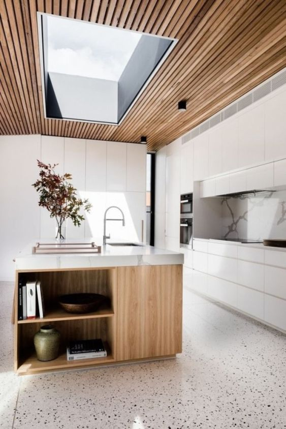 kitchen, terazzo floor tiles, wooden island with marble top, white cabinet, marble backsplash, wooden slat ceiling, clear glass ceiling