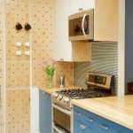 Kitchen, White Floor, Blue Bottom Cabinet, Wooden Top, Wooden Upper Cabinet, Wooden Pegboards On The Side Wall