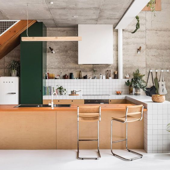 kitchen, white floor, white square backsplash wall, white square top tiles, green pantry, pink island with pink top
