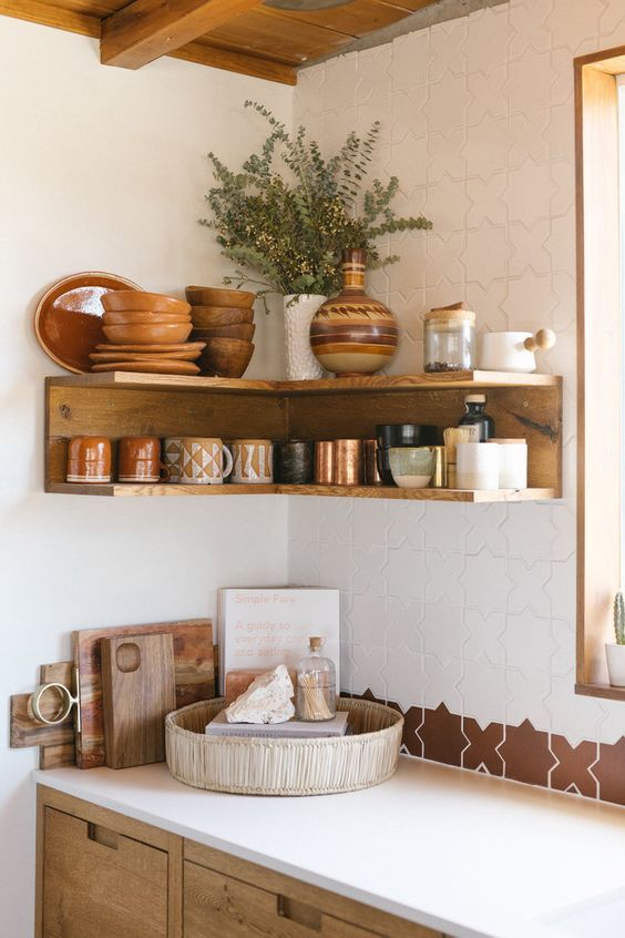 kitchen, white kitchen top, wooden bottom cabinet, wooden corner floating shelves, white wall, tiles on the kitchen top frame