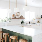 Kitchen With White Marble Top, White Cabinet, White Hexagonal Wall Tiles, White Ball Pendants, Green Under The Kitchen Island, Wooden Stool